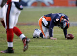(1695) Jay Cutler is shaken up after being hit in the third quarter of the Denver Broncos against...