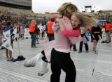 Hannah Marshall, 13, is hugged and swung around by her mother, Jewels Marshall, 45, of Boulder,...