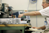 StorageTek employee Mark Watson (cq) of Louisville tests a tape path for performance in a lab at...