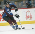 0428 Colorado Avalanche defenseman Adam Foote (52) skates down ice in the third period at the...