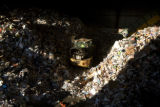 Antonio Beltran (cq)  moves recycling material into a machine that will begin sorting at...