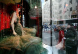 NYML205 - A woman stops to look at a Saks Fifth Avenue window display Monday, Nov. 24, 2008 in New...