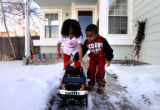 (PG6448) Jaida Key and her cousin Kyshaun Key play with Kyshaun's new remote-controlled Hummer...