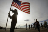 (2317) Flag Bearer Alex Queen holds the American flag as the Windsor High School Band practices at...