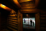 MJM752  Skaters are seen through a window of the Evergreen Lake warming hut on New Years Eve...