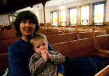 (0045) Walker Hughes is held by his nanny Jeannie Hughes at the Advent Organ Recital at Trinity...