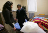 (0118) Nicole Dangler and Jennifer Janz, right, pray together before Dangler sleeps on the floor...