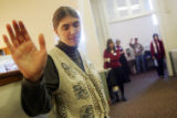 (0272) A woman prays at Providence Bible Church in Denver., Colo., on Sunday, Dec. 21, 2008....