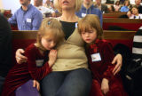 (0338) Rhonda AuYeung, center, holds her nieces, Rhonda Amoroso, left, and Mary Amorosos, right,...