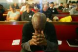 (0362) Vincent Devoe prays during Sunday service at Providence Bible Church in Denver., Colo., on...