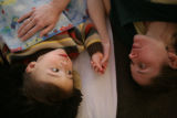 Logan Hosmer, 1 (cq) lays with Rachel Carey (cq) who works with the YWCA of Boulder County at 2222...