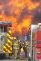 Firefighters worka fully engulfed house fire on Wednesday afternoon off of Neva Roade and 45th...