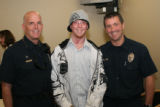 Devin Barnhart, 23, center, who survived the fire with burns over 70% of his body. Barnhart was...