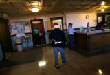 (PG3698) Jimmy Vance, who has developmental disabilities, delivers Christmas gifts to workers at...