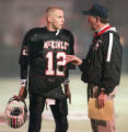 McKinley quarterback Ben McDaniels gets some last minute advice from head coach and father Thom...