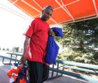 Tatum Bell leaves with his belongings at Bronco Headquarters in Centennial, Colo. Monday, December...
