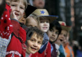 Kindergartners from Polaris at Ebert Elementary School enjoy the parade moving down 17th St. from...