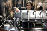 Jackie Thompson, the winemaker at Boulder Creek Winery in Boulder, CO,  clean a wine bottler after...