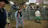 John Ennslin gets in the ring with other clowns and Lance Brittan and a ring of cowboys at the...