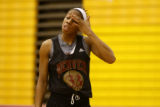 Nnenna Akotaobi  takes a breather during practice at the University of Denver, Denver, Colo. on...