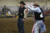 John Ennslin redies his stance and waves his arms to face the bull at the Island grove Arena in...