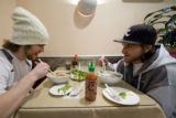 Dosh Parker and Bryan Kulbe of Aurora, Colo. enjoy some PHO (soup) after a long day of snow...