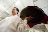 John Nguyen of Denver serves appetizers at The Dong Khanh Appetizers at Saigon Bowl at 333 S....