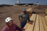 (Lt. to Rt.) Third generation wood mill workers Rafael Delgado Arellano (cq), and Gilberto...