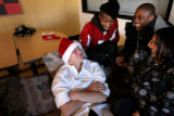 (PG6273) Young adults at the Urban Peak homeless shelter in Denver, Colo., wait for Santa Claus to...