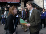 Andrea Lewis gives her resume to Michael Bennet after he and Gov. Ritter held a commuity forum at...