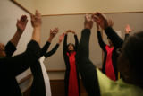 Kamaria Hakeem, 18, (cq) begins to say a prayer with her dance partners The Redeemers from the...