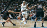 0035 Philadelphia 76ers guard Andre Miller (7) stripes the ball from Denver Nuggets forward Kenyon...