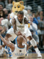 0358 Denver Nuggets guard J.R. Smith (1) helps teammate Chauncey Billups (7) in the fourth quarter...