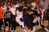 (1760) Jay Cutler is pushed out of bounds by Antoine Cason in the third quarter of the Denver...