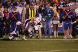 (1802) Brandon Stokely is tackled in the third quarter of the Denver Broncos against the San Diego...