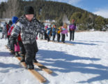 Elk Creek Elementary 1st grader, Dillan Flleming, leads his team in the board race during the...