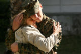 MJM145  Pauses in front of the media, Lance Cpl. Lance Hering hugs his mother, Elynne Hering...