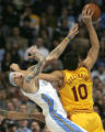 (0763)Wally Szerbiak fouls Chris Andersen in the first half of the Denver Nuggets against the...