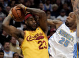 (0565)Anthony Carter tries to steal the ball from LeBron James in the first half of the Denver...