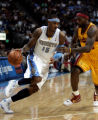 (1024)Carmelo tries to drive past LeBRon James in the first half of the Denver Nuggets against the...