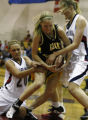 In 5A girls basketball Chaparral's #20 Courtney Gallo and #42 Anna Faul Green Mountain's #10...