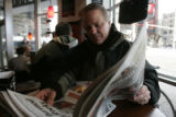 Jim Sorenson reads the Rocky Mountain News during his lunch at Jimmy Johns  Friday December 5,...