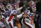 [JPM0952] Buffalo Bills safety Donte Whitner (20) celebrates with  Buffalo Bills linebacker Kawika...