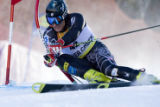 DM1354  BirdsOfPrey56022 American skier Tim Jitloff bends back a gate during the first round of...