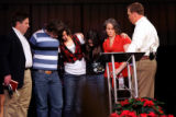 (PG2358) Pastor Brady Boyd (right) leads a prayer for the Works family during a service around the...