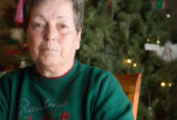 Lee Monson of Parker, Colorado sits among the Christmas decorations at the home of her son Jim...