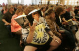 "Jack Marley, cq, 39, of Centennial, reads Jane Fonda's new book ""My Life so Far"" as he..."