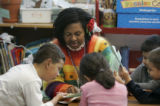 ECL paraprofessional Angela Boyd teaches reading to kindergartners at East Elementary School in...