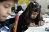 Viridiama Garcia, right,  and Ben Barco, work on a math project during a specialized fifth grade...