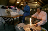 Family members of 64-year-old Ying Yang, a member of the Hmong community mourn her death during a...